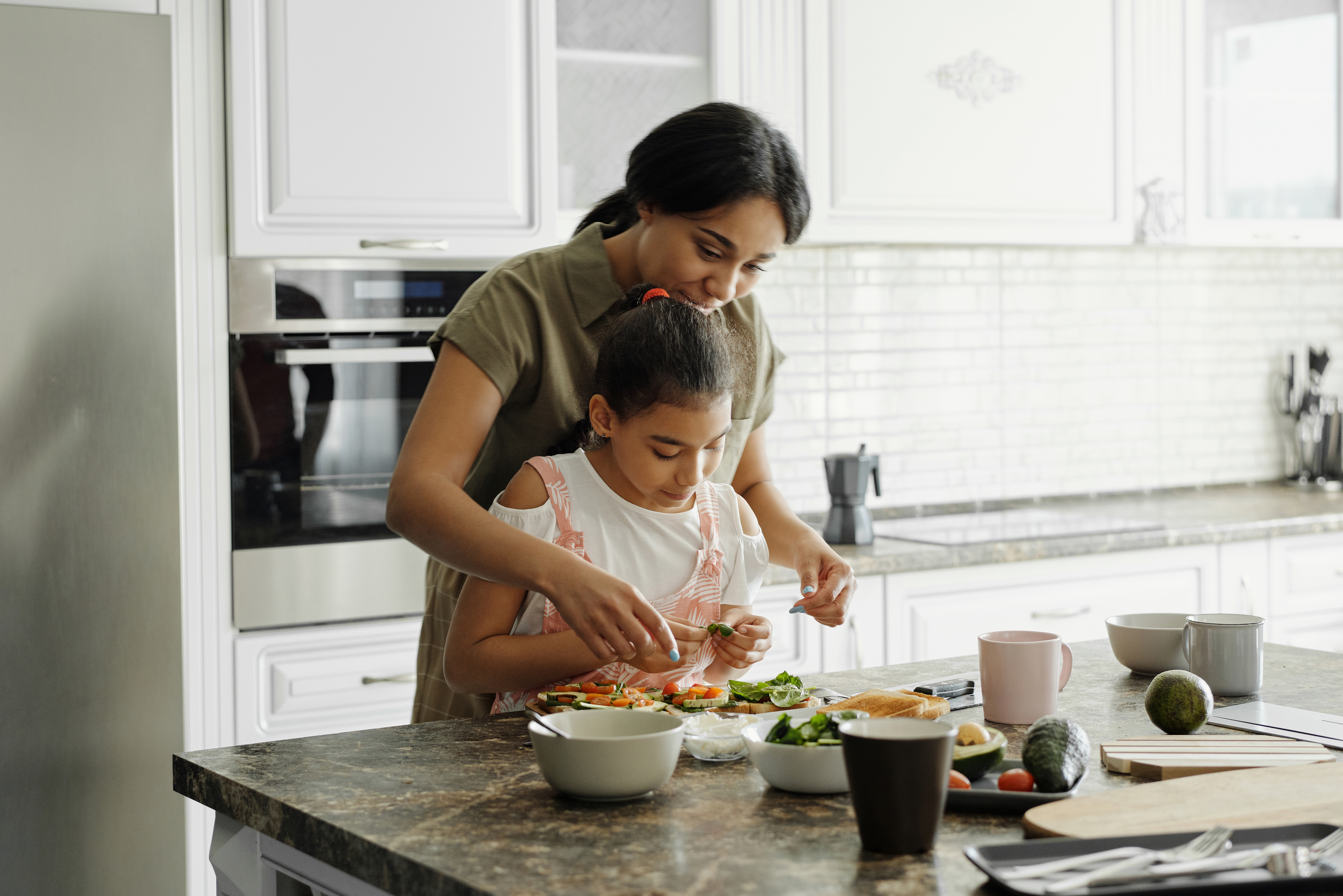 mother-and-daughter-preparing-avocado-toast-4259707
